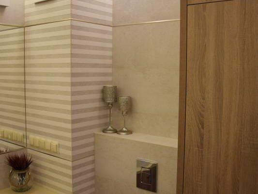 Drewniane szafki w łazience zaprojektowanej przez architekta wnętrz Białystok