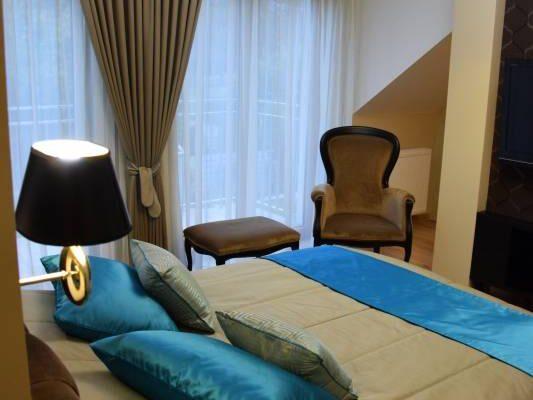 Zaprojektowane przez projektanta wnętrz wnętrze sypialni Białystok